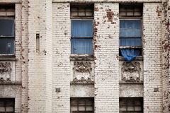 Old building and blue curtain Stock Image