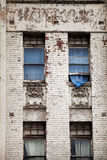 Old building and blue curtain Stock Photos