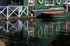 OLD BUILDING AND BOAT REFLEXAATION IN WATER Royalty Free Stock Photos