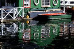 OLD BUILDING AND BOAT REFLEXAATION IN WATER Royalty Free Stock Photo