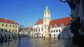 Old building of bratislava city museum with tower. And blue sky in winter time royalty free stock photo