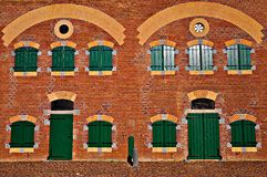 Old building with brick facade. And windows Royalty Free Stock Images