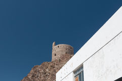 Old building in the center of Muscat in Oman. Ancient building in Contrast between white buildings and blue sky. Muscat, Oman Royalty Free Stock Image