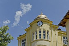 Old building with clock in mountain town Peshtera Stock Photo