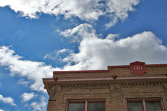 Old building and cloudscape. Exterior of old building with 1911 sign; blue sky and cloudscape background, Hillsboro, Oregon, U.S.A Royalty Free Stock Photography