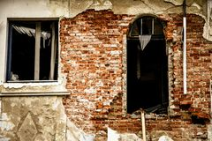 Old building with a collapsing brick facade stock photo