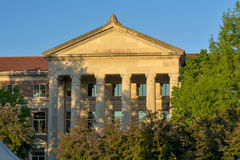 Old building on a college campus at sunrise Royalty Free Stock Photography