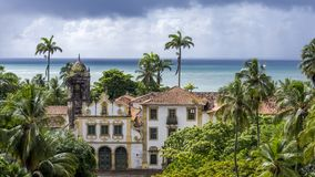 Old building of colonial architecture with the sea in the background royalty free stock photo