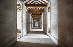 Old building corridors. An old building corridors, doors, wooden roof structure royalty free stock images