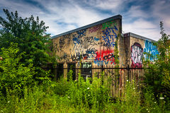Old building covered in graffiti, seen from the Reading Viaduct Royalty Free Stock Photo