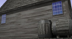 Old Building. 3D illustration of the side of an old building with two wooden barrels in the front. There is enough blank space on the side of the building to Royalty Free Stock Image