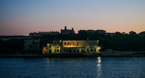 An old building at Dusk. From Sliema in Malta stock photography