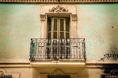 Old building elevation - vintage balcony, shutters and ornaments Royalty Free Stock Images