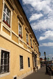 Old Building Facade. Exterior facade of an old historic building fading into the distance, located in the castle district of Budapest on a beautiful summer day Stock Photo