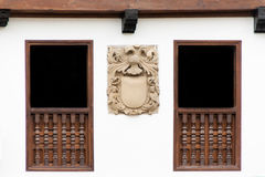 Old building facade with a coat of arms Royalty Free Stock Photo