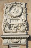 Old building facade, coat of arms symbol. Old soviet building facade with coat of arms symbol Stock Photos