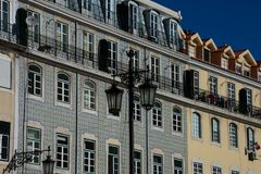 Old building facade with Lisbon traditional tiles. Lisbon, Portugal stock image