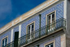 Old building facade with Lisbon traditional tiles. Lisbon, Portugal royalty free stock images