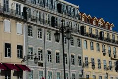 Old building facade with Lisbon traditional tiles. Lisbon, Portugal royalty free stock photography