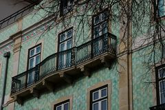 Old building facade with Lisbon traditional tiles. Lisbon, Portugal royalty free stock photo