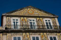 Old building facade with Lisbon traditional tiles and paintings. Lisbon. Portugal. January 24, 2018. Old building facade with Lisbon traditional tiles and stock photo