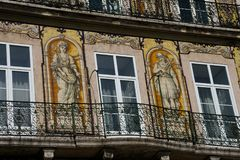 Old building facade with Lisbon traditional tiles and paintings. Lisbon. Portugal. January 24, 2018. Old building facade with Lisbon traditional tiles and royalty free stock photography