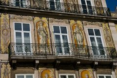 Old building facade with Lisbon traditional tiles and paintings. Lisbon. Portugal. January 24, 2018. Old building facade with Lisbon traditional tiles and royalty free stock images