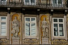 Old building facade with Lisbon traditional tiles and paintings. Lisbon. Portugal. January 24, 2018. Old building facade with Lisbon traditional tiles and stock photos