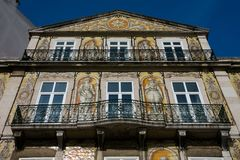 Old building facade with Lisbon traditional tiles and paintings. Lisbon. Portugal. January 24, 2018. Old building facade with Lisbon traditional tiles and royalty free stock image