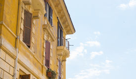 Old building facade with windows in Rome Stock Photo