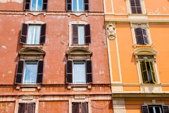 Old building facade with windows in Rome Royalty Free Stock Image