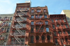 Old building with fire escape, NYC. Old building with fire escape, Manhattan, New York City, USA Royalty Free Stock Images