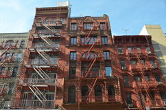 Old building with fire escape, NYC. Old building with fire escape, Manhattan, New York City, USA Stock Photos