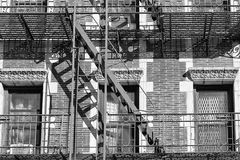 Old Building fire ladder in black and white Royalty Free Stock Images