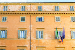 Old building and flag in Italy Royalty Free Stock Photo