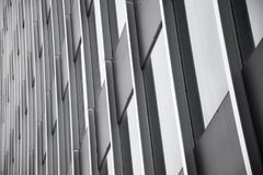 Building with glass windows in black and white royalty free stock image