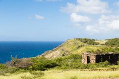 Old Building on Green Hill Over Blue Sea Royalty Free Stock Photo