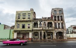 HAVANA, CUBA - OCTOBER 21, 2017: Old Building in Havana, Unique Cuba Architecture. Old Car in Foreground. Old Building in Havana, Unique Cuba Architecture. Old Stock Photography