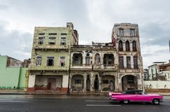 HAVANA, CUBA - OCTOBER 21, 2017: Old Building in Havana, Unique Cuba Architecture. Moving car in foreground. Old Building in Havana, Unique Cuba Architecture Stock Photography