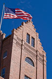 Old building flying the American flag. An old building in historic Ybor City flying the American flag stock photos