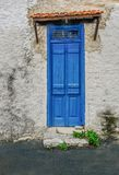 Old blue wooden doors that are shut. Old building with interesting blue wooden doors that are closed.  Vibrant blue in colour and a grill pattern at the top Royalty Free Stock Photography