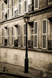 Old building with lamp post in Paris in sepia Royalty Free Stock Photo