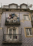 And old building, Lisbon, Portugal. A view of a tiled old building in Lisbon, Portugal. There are two balconies visible with some laundry drying in the wind Stock Photos