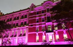 Old building lit in pink. Historic building with lit with pink lights Royalty Free Stock Photo