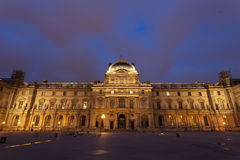 Old building in Louvre Museum. At twilight time Royalty Free Stock Photos