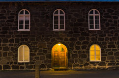 Old building made of stone in city of Reykjavik at twilight Stock Photo
