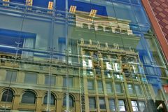 Old Building New Building. Old building reflected in windows of modern downtown San Francisco department store Stock Images