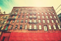 Old building in New York City at sunset, USA. Royalty Free Stock Photo