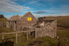 Old Building next to Stoer Lighthouse lochinver stock photo
