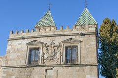 Old building of a noble family with shield and green roofs typical of the area Toledo. stock photography